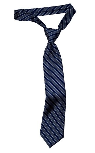Classic stripped necktie with a Windsor knot and the typical dimple below the knot.