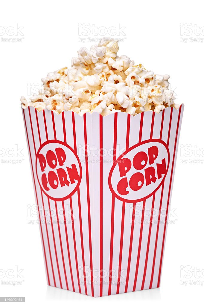 Striped red and white popcorn box filled with popcorn stock photo