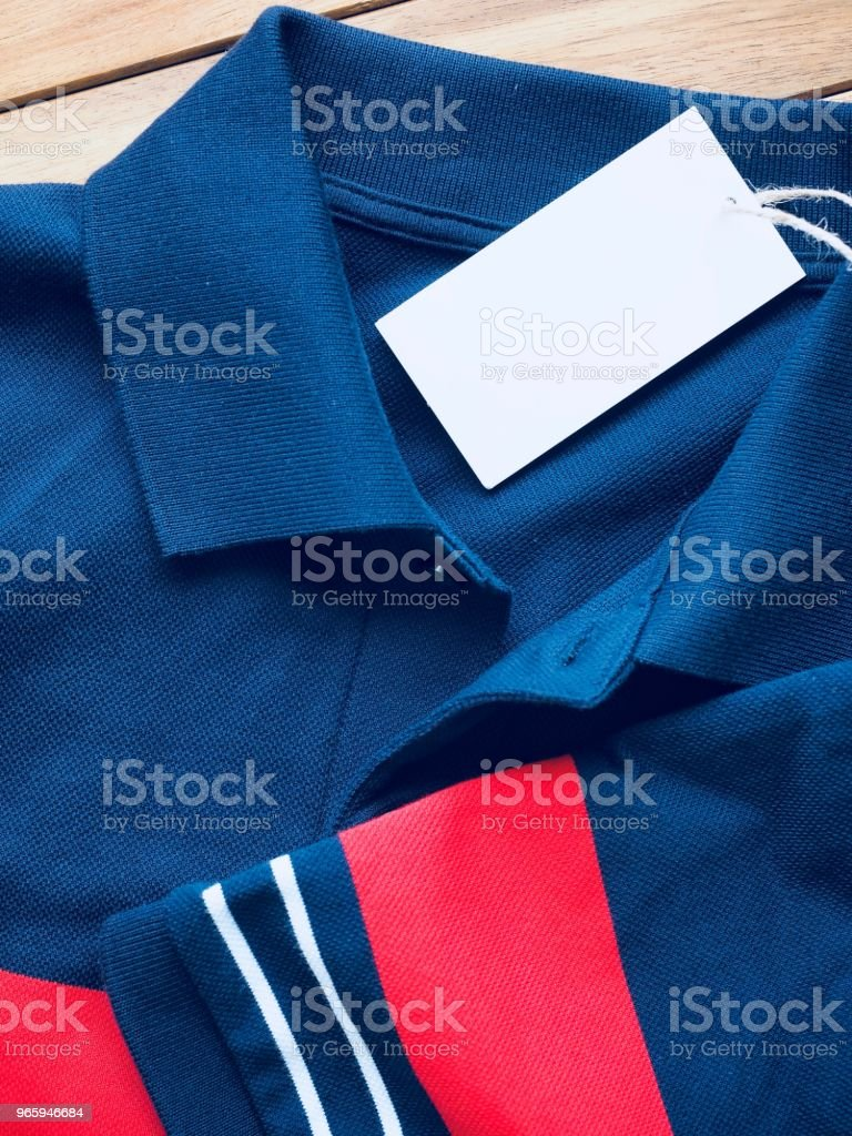 Gestreepte ronde Short Sleeve T-shirt, kleding label - Royalty-free Azië Stockfoto
