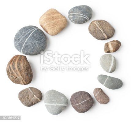 Striped stones arranged to a circle – isolated on white with original shadows