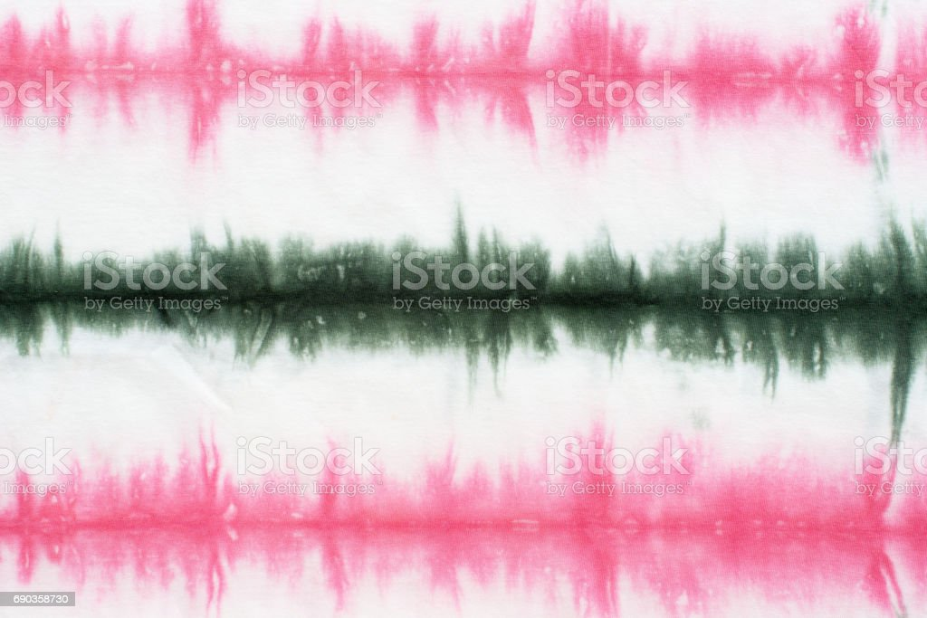striped tie dye tie dye pattern hand dyed on cotton fabric background.