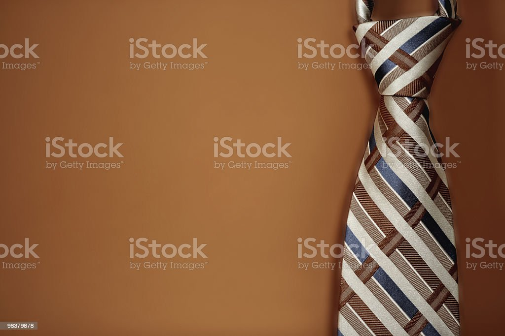 Striped tie on the dirty orange background. royalty-free stock photo