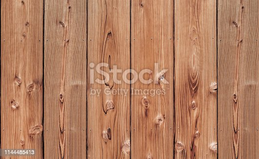 Close up shot of striped plank wood in vertical lines