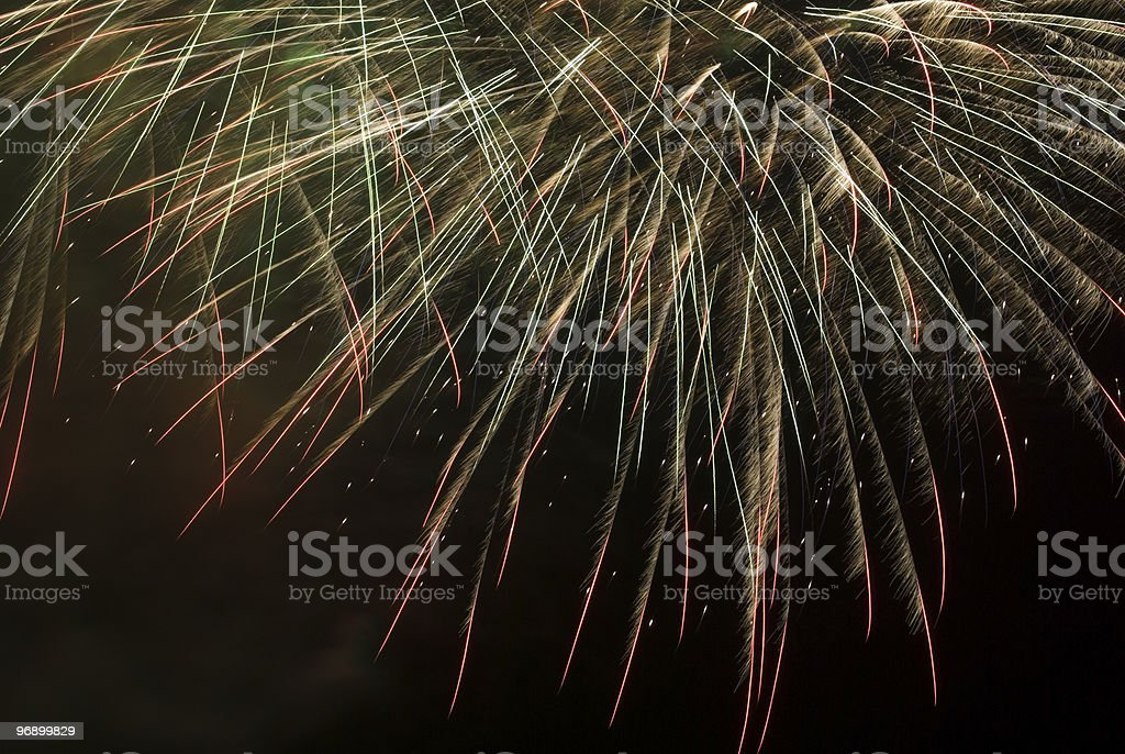 Stripes of green and red fireworks in the dark royalty-free stock photo