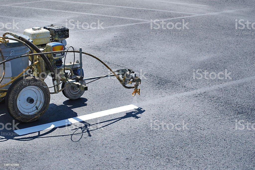 Striping Lines onto fresh asphalt stock photo