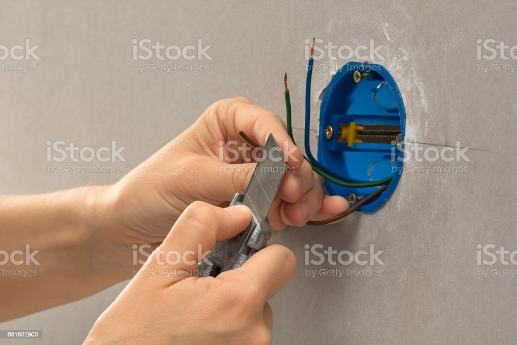 striping the insulation of wires with cutter stock photo