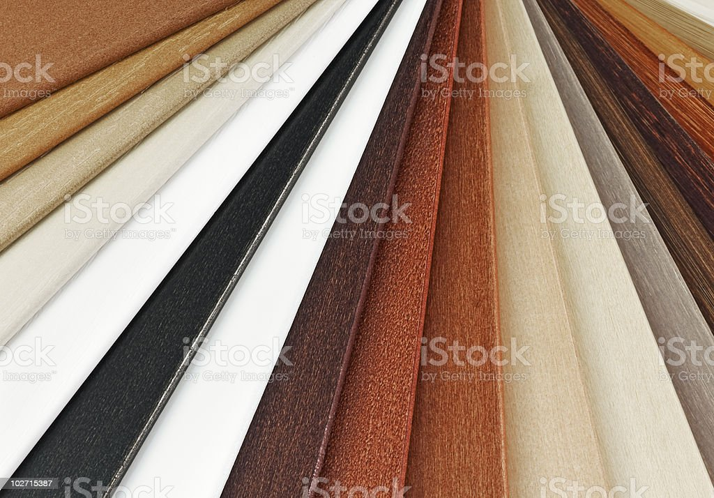 Strips of laminate flooring samples in various colors royalty-free stock photo