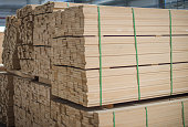 Strips of MDF piled in stacks. Selective focus.