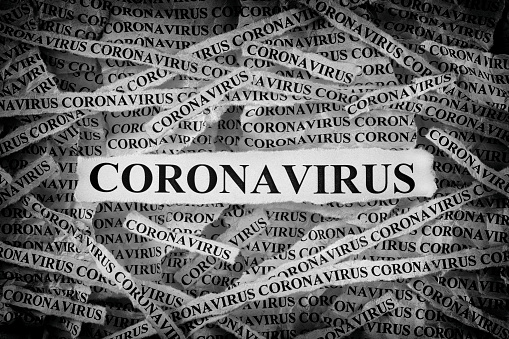 Strips of newspaper with the word Coronavirus typed on them