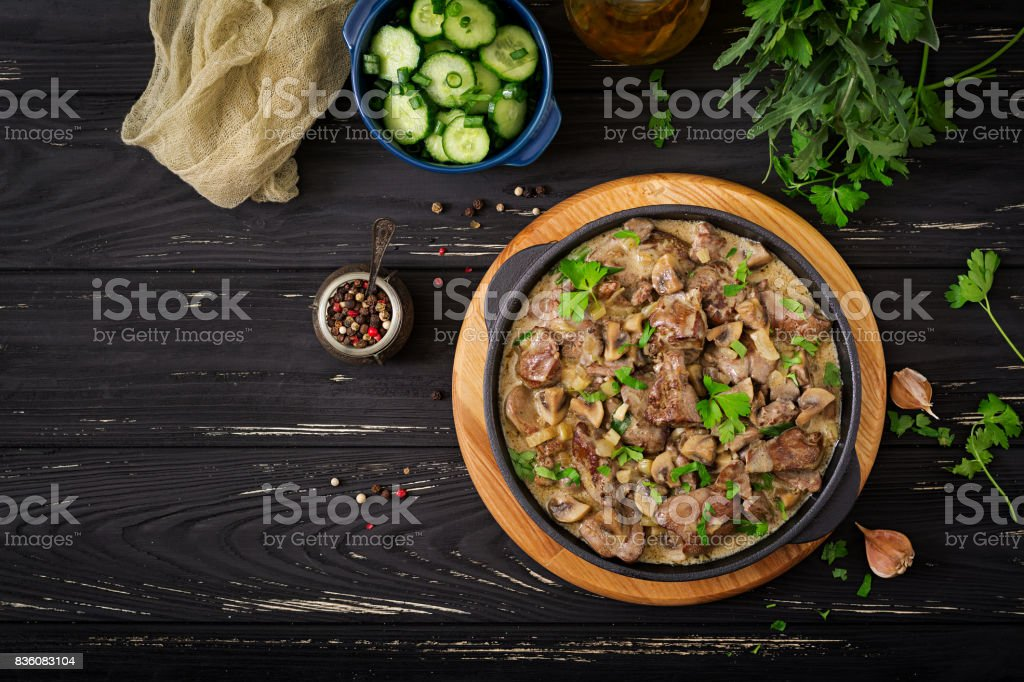 Stroganoff chicken liver with mushrooms and cream. Flat lay. Top view stock photo