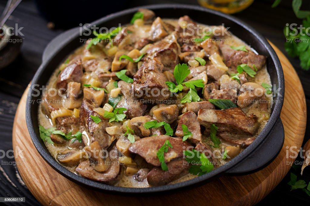 Stroganoff chicken liver with mushrooms and cream stock photo