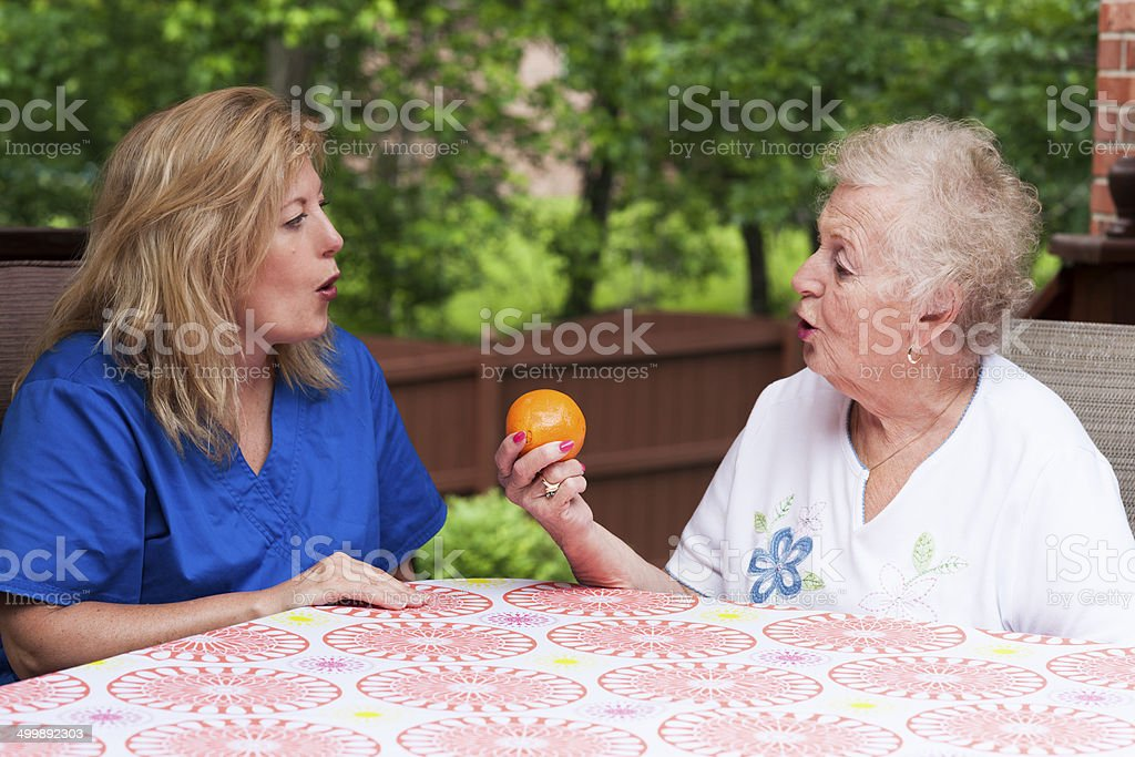 Stroke patient in apraxia speech therapy stock photo