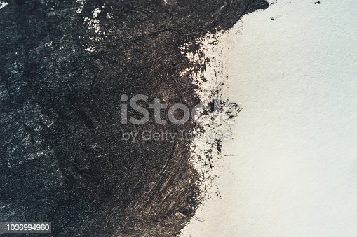 850235550 istock photo Strokes of black paint on a white background 1036994960
