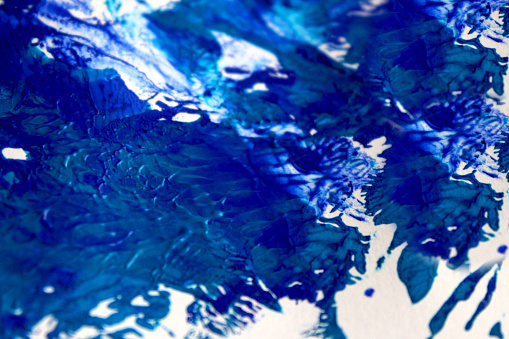 1084390994 istock photo Strokes of blue paint on white paper background or texture 1190985721