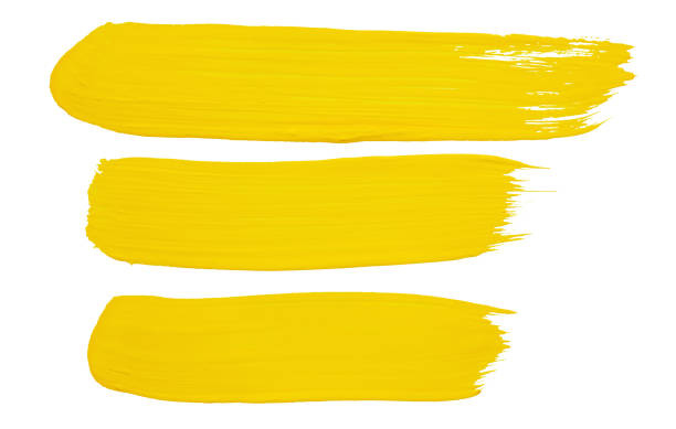 strokes of yellow paint - stroking stock pictures, royalty-free photos & images
