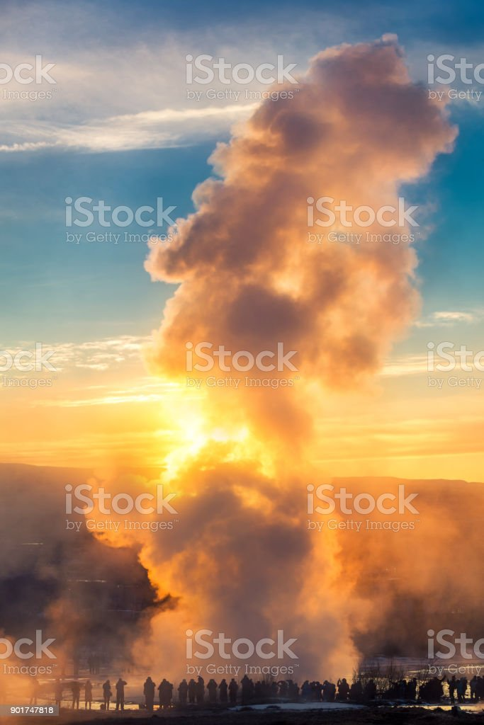 Strokkur geyser erupts at sunrise stock photo