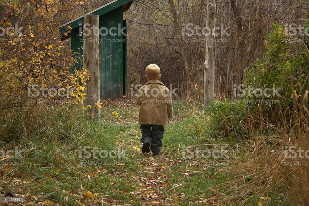 Stroll to the outhouse stock photo