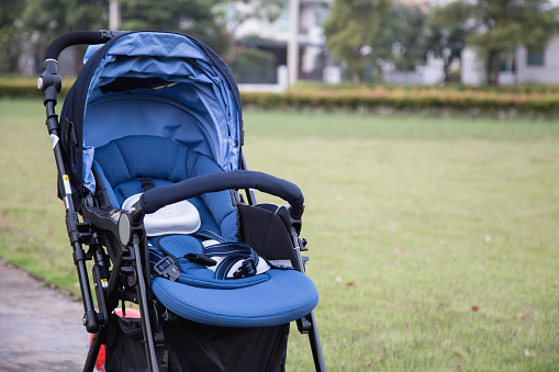 Stroller Carriage For Baby In The Garden Stock Photo - Download Image Now