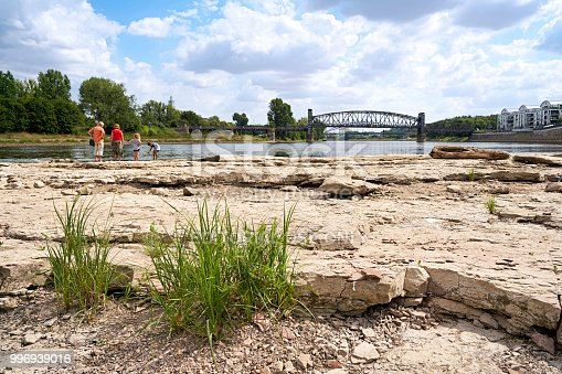 Magdeburg, Germany - July 08, 2018: Strollers on the Cathedral-Rock in Magdeburg. The rock is usually located under water and is visible only under heavy drought.