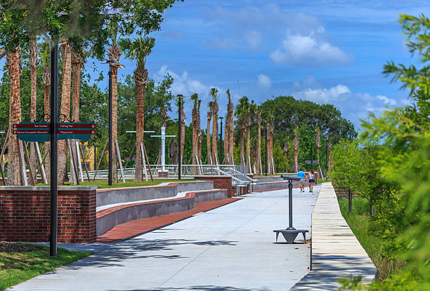 strolling through the park in kissimmee fl - kissimmee stock photos and pictures