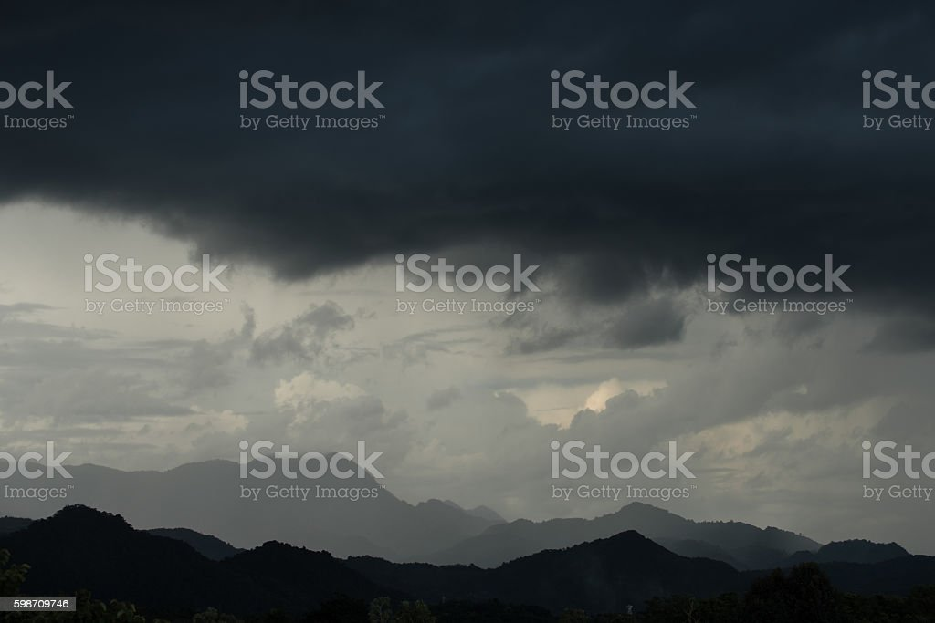 Strom and big black cloud over mountain stock photo