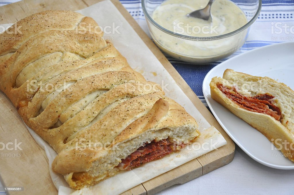 Stromboli - italian sandwich filled with ham and cheese royalty-free stock photo