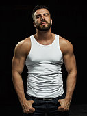 istock A strong, a serious, muscular man 958551928