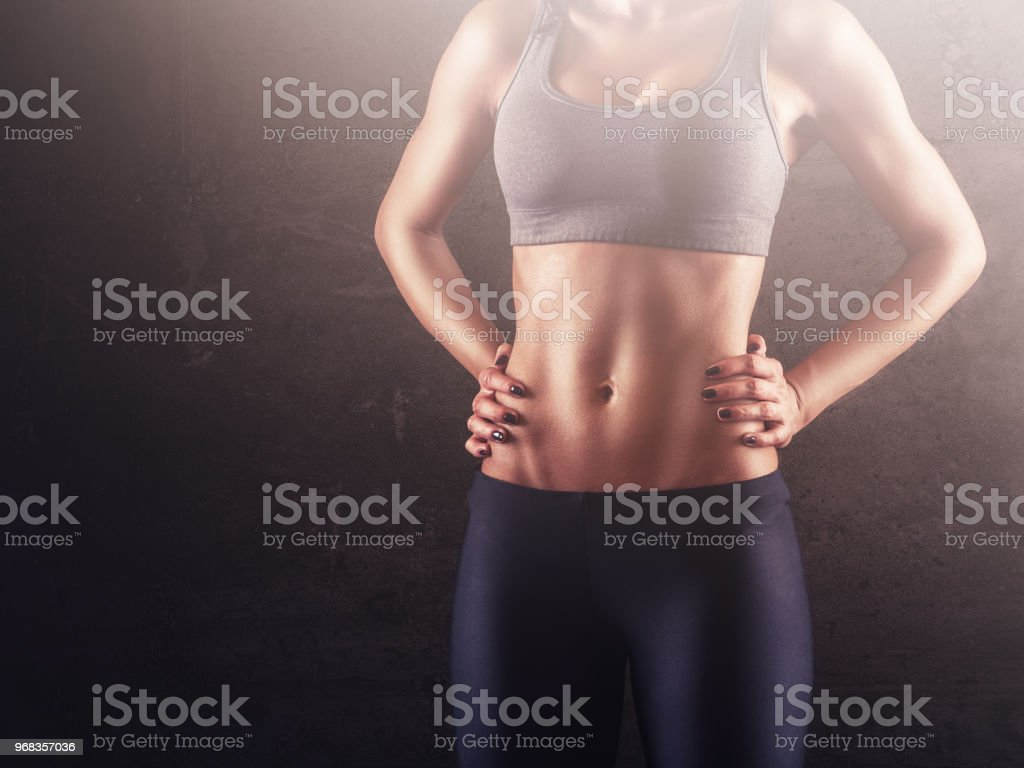 Strong abdominal muscles of sporty woman stock photo