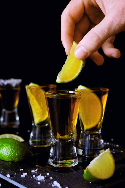 strong alcohol drinks. tequila glass shots in the bar with salt and lime slices. - mezcal fotografías e imágenes de stock