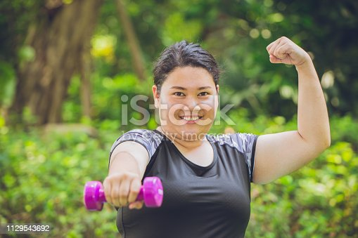 Strong and healthy overweight fat girl, outdoor sport activity teen concept.