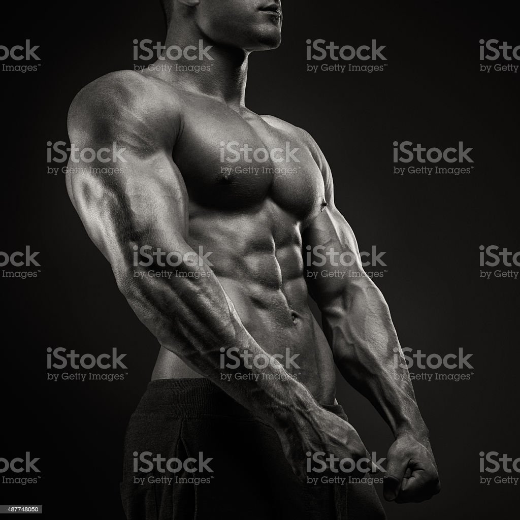 Strong and power bodybuilder posing stock photo