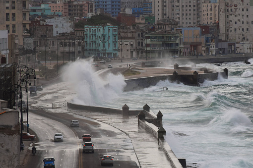 Strong and rough waves hit the shore in the city