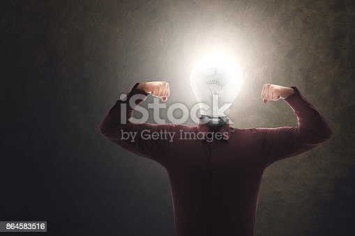 istock strong and skilled creative man with bulb on his head 864583516