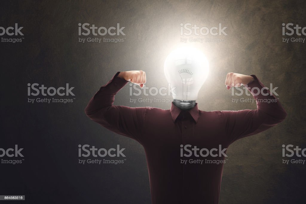 strong and skilled creative man with bulb on his head stock photo