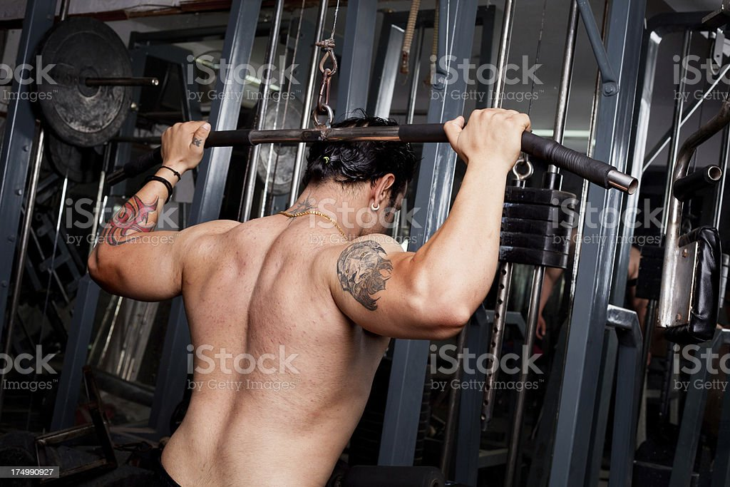Strong Asian Indian Man Exercising in Gym stock photo