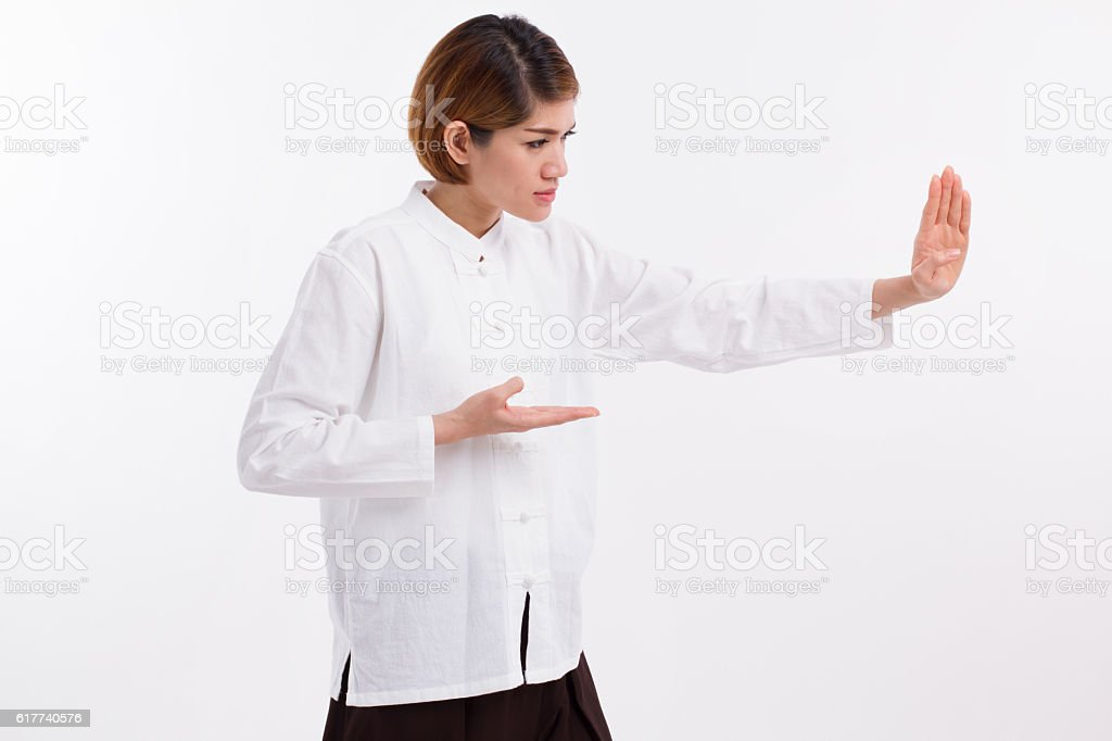 strong asian woman practice kungfu or taichi stock photo