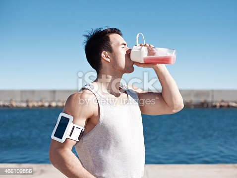 852024650istockphoto Strong athlete drinking protein cocktail 466109866
