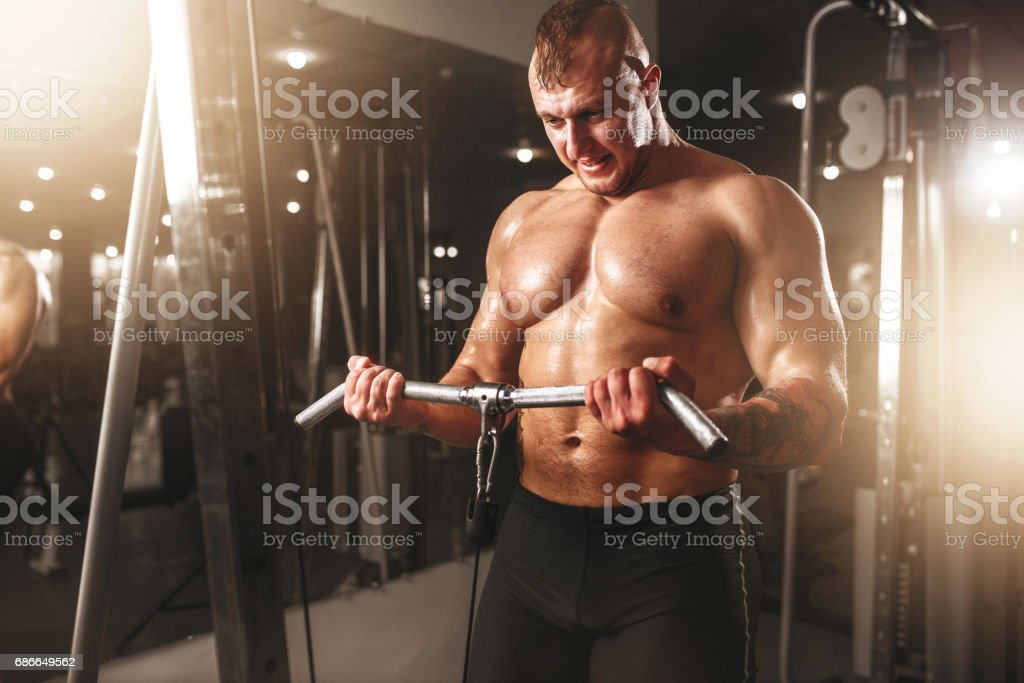 Strong athlete with muscular body lifting barbell royalty-free stock photo