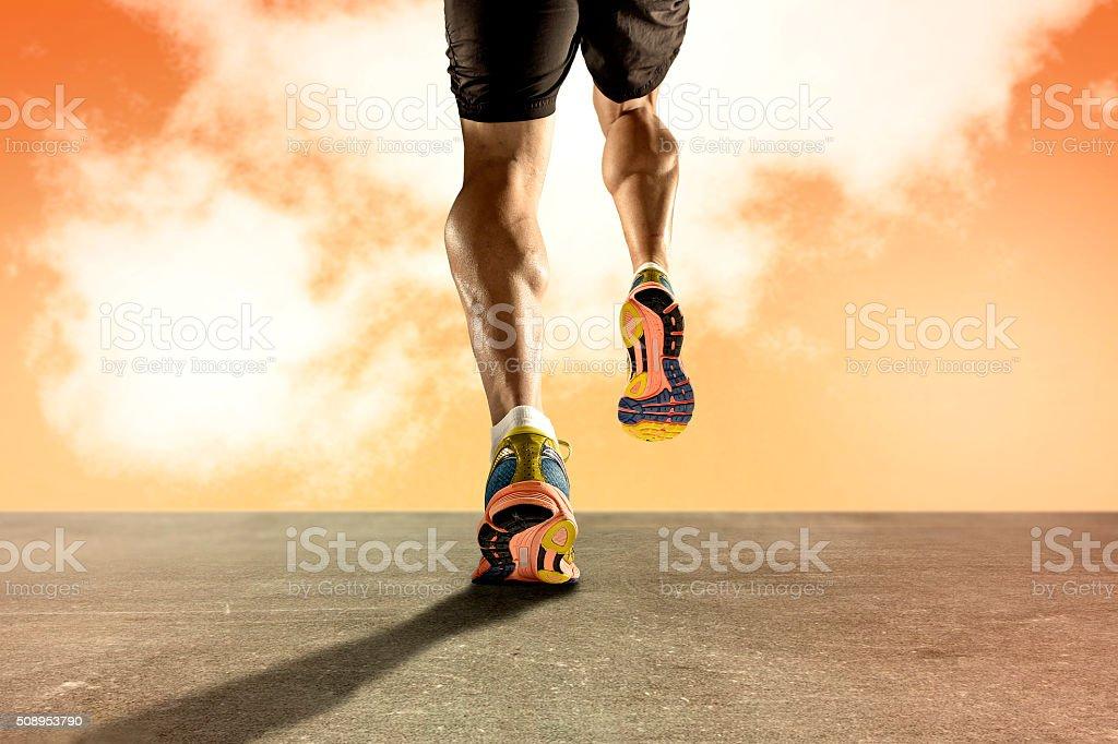 strong athletic legs sport man running asphalt road sunset sky stock photo