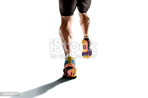 istock strong athletic legs with ripped calf muscle sport man running 508953878