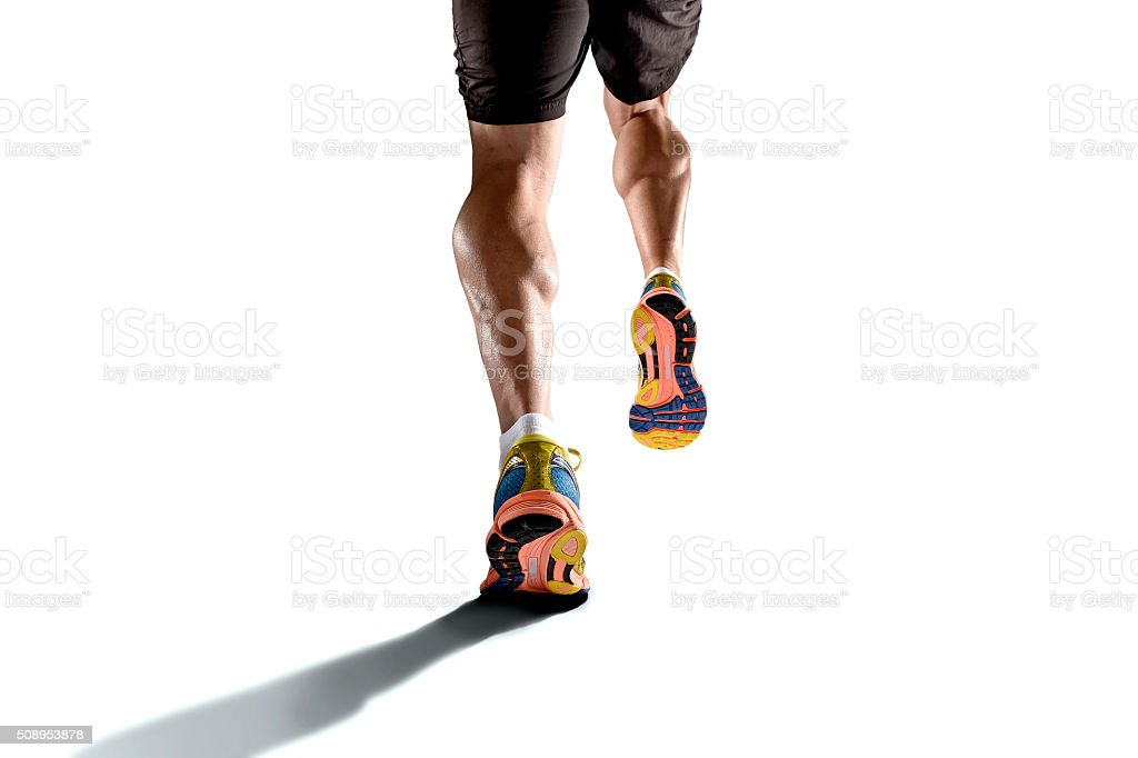 strong athletic legs with ripped calf muscle sport man running stock photo