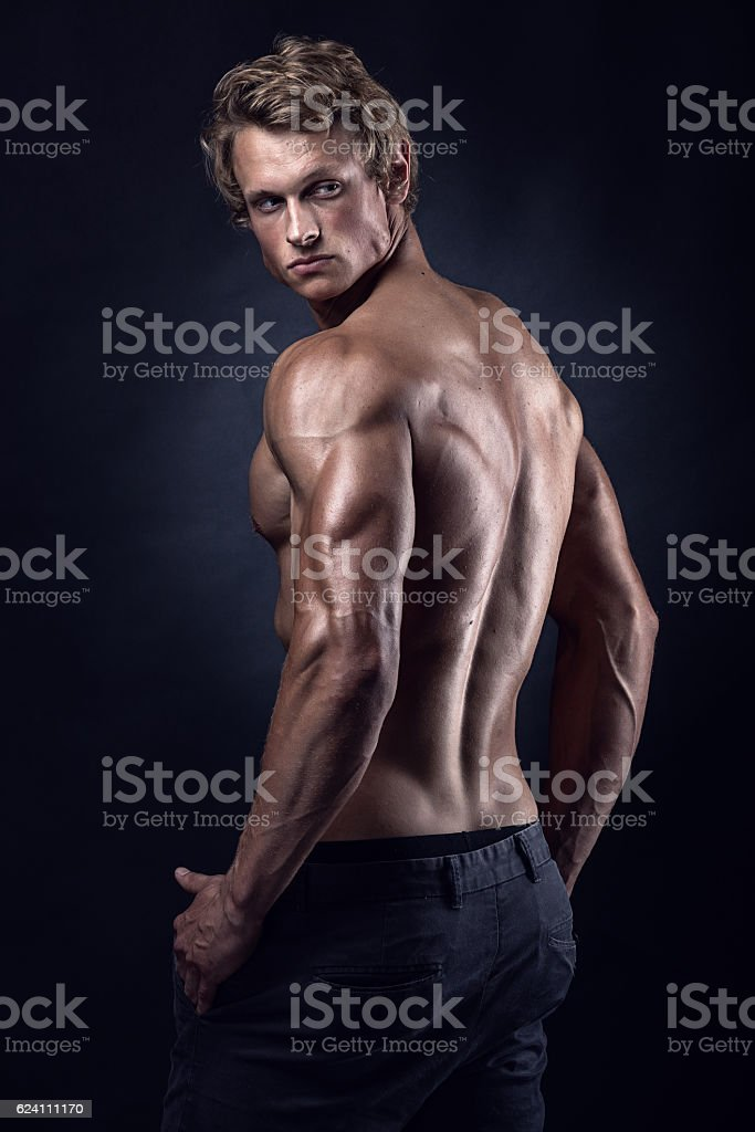 Strong Athletic Man Fitness Model posing back muscles stock photo
