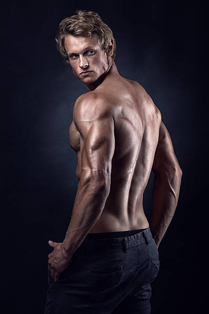 Strong Athletic Man Fitness Model posing back muscles Strong Athletic Man Fitness Model posing back muscles, triceps, latissimus shirtless male models stock pictures, royalty-free photos & images