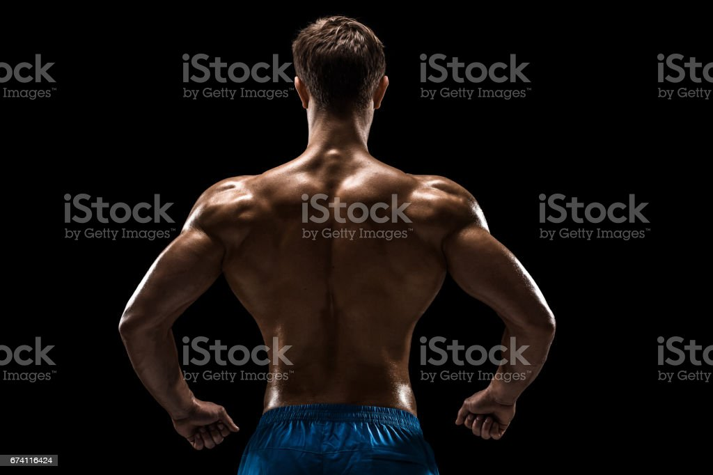 Strong Athletic Man Fitness Model posing back muscles, triceps over black background royalty-free stock photo