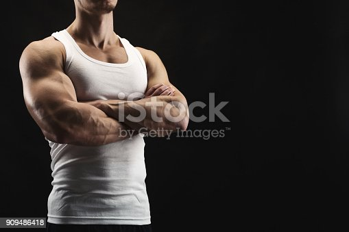 istock Strong athletic man showes naked muscular body 909486418