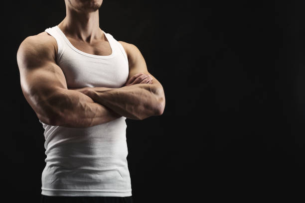 Strong athletic man showes naked muscular body stock photo