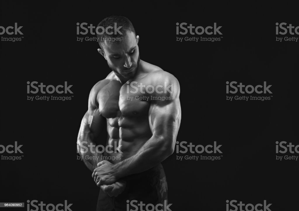 Strong athletic man showes naked muscular body - Royalty-free Abdominal Muscle Stock Photo
