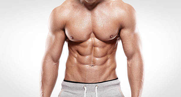 Strong Athletic Man  showing muscular body Strong Athletic Man  showing muscular body and sixpack abs over white background shirtless male models stock pictures, royalty-free photos & images