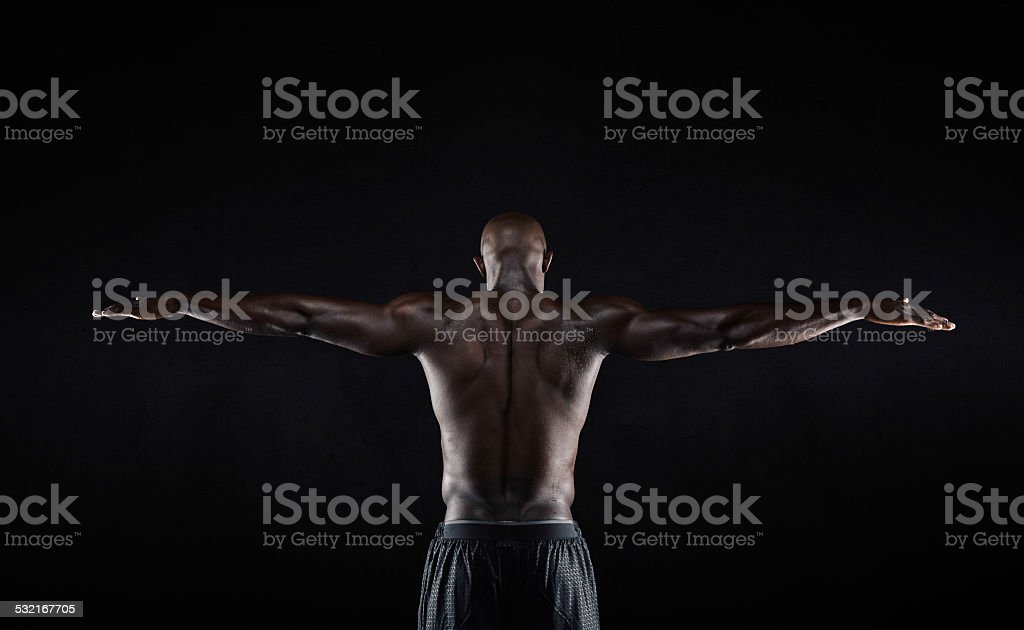 Strong back of a black muscular man stock photo