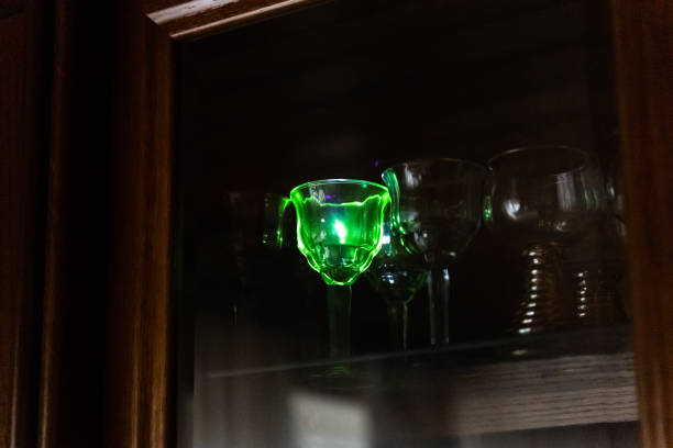 Strong blue laser pointer hits a crystal glass stock photo
